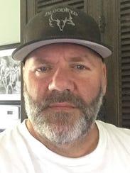 Licensed agent alligator trapper Craig Breland was