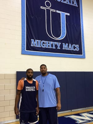 Immaculata coach Terrence Stewart with senior guard Ron Melton of Winslow Township
