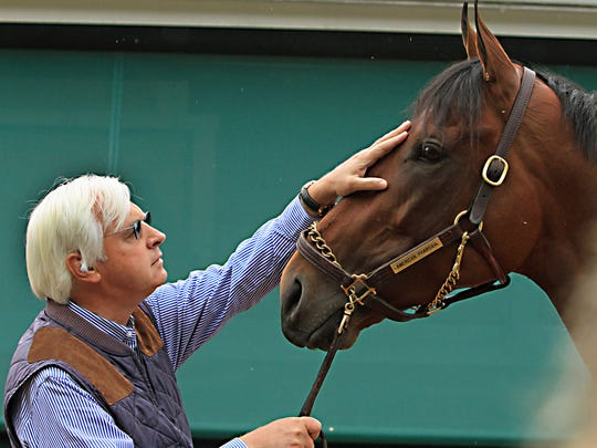 Trainer Bob Baffert rubs the head of Preakness Stakes