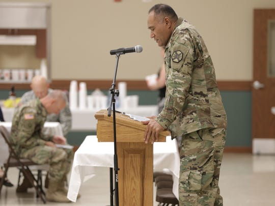 Fort Bliss chaplain Lt. Col. Vaio T. Leau gives the opening prayer Thursday at the Community Religious Leadership Summit at Fort Bliss.