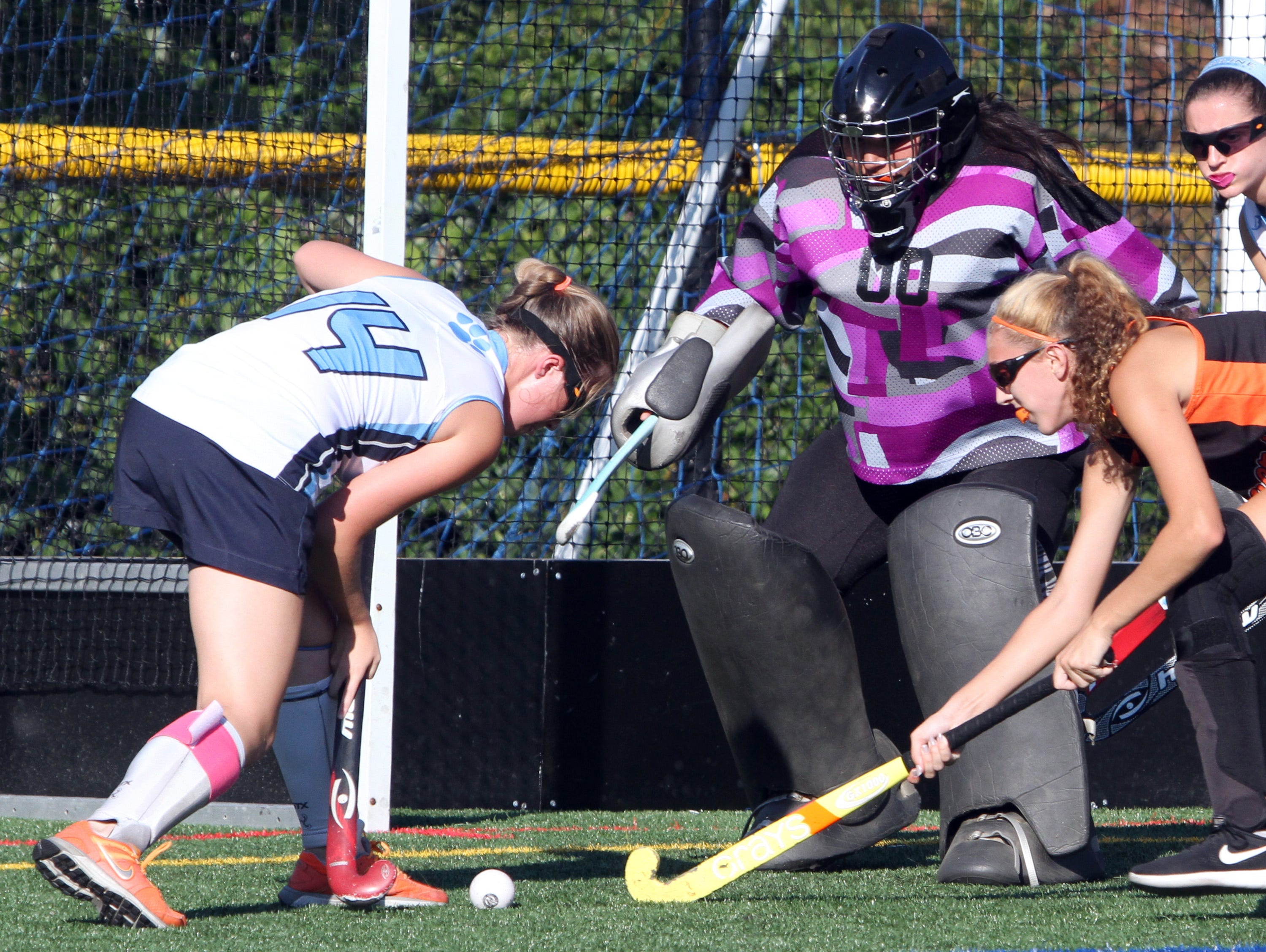 Ursuline's Katie Gies tries to set up a shot in front of White Plains goalie Jen Ortega-Salazar during a varsity field hockey game at the Ursuline School in New Rochelle Sept. 23, 2016.
