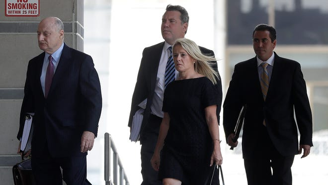 Bridget Kelly, foreground center, former New Jersey Gov. Chris Christie deputy chief of staff, arrives with attorney Michael Critchley, left, at the Martin Luther King Jr. Federal Courthouse for a hearing, Thursday, July 7, 2016, in Newark, N.J. Kelly and Bill Baroni have subpoenaed texts and other communications from Gov. Chris Christie's office as they defend themselves against federal charges for allegedly creating traffic jams to punish a local Democratic mayor for not endorsing Christie.