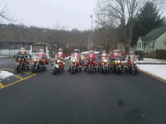 Wanaque's motorcycle Santas line up Dec. 17, 2017. From left to right: Scott Marks, Mike Thacker, Lt. Charlie Huber, Kevin Watts, Frank Pricken, Raul Kuhar, Paul Johannemann, and Mike Slepakoff. In the back is Frank Covelli. Not pictured is Jason Roettgger.