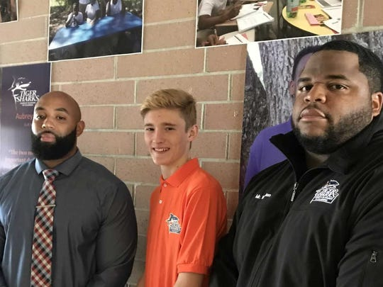 Aubrey Lister, center, is heading to Florida A&M University,