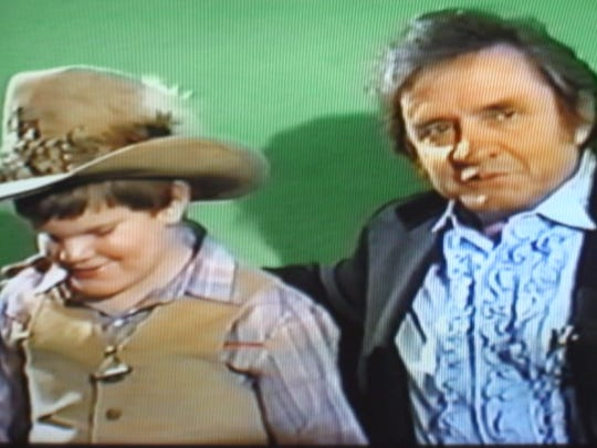 Johnny Cash with Brian Knapp on TV in 1982.