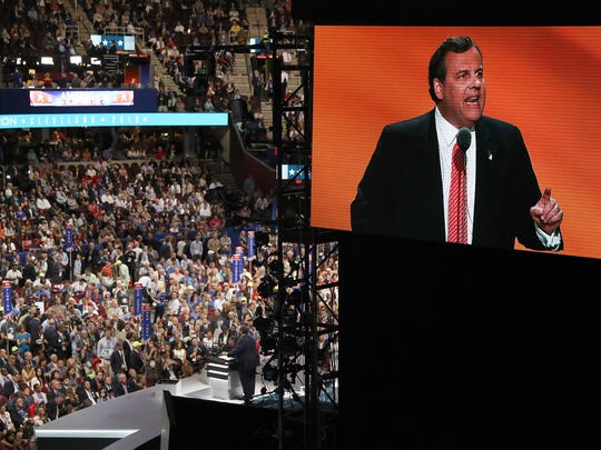 NJ Governor Chris Christie appears on screens as he speaks at the Republican National Convention at the Quicken Loans Arena in Cleveland Tuesday July 19, 2016.
