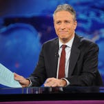 "FILE - This Nov. 30, 2011 file photo shows television host Jon Stewart during a taping of ""The Daily Show with Jon Stewart"" in New York. Stewart will sign off for good on Aug. 6. (AP Photo/Brad Barket, File)"