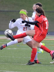 Northville's Sydney Schembri (left) takes on Canton's Madison Archibald.