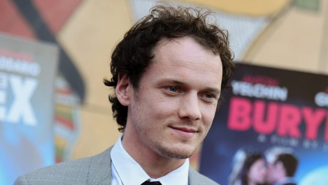 Anton Yelchin arrives at a screening of 'Burying the Ex' at Grauman's Egyptian Theatre in Los Angeles on June 11, 2015. The actor died Sunday at 27.