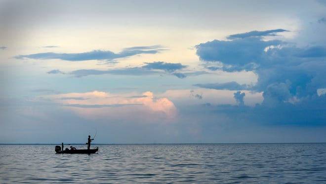 An angler fishes July 26 on Mille Lacs Lake.