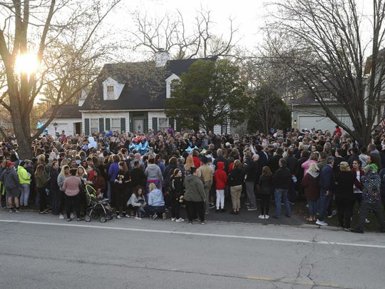 """Mourners gather outside the home of 5-year-old Andrew """"AJ"""" Freund for a vigil Wednesday, April 24, 2019, in Crystal Lake, Ill. Andrew's body was found in a wooded area in Woodstock Wednesday, and the boy's parents have been charged with his murder."""