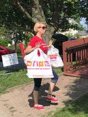 Julie MacMillan, lead negotiator for the nurses union at UVM Medical Center,, brings in fuel in the form of doughnuts to the picket lines on Friday, July 13, 2018.