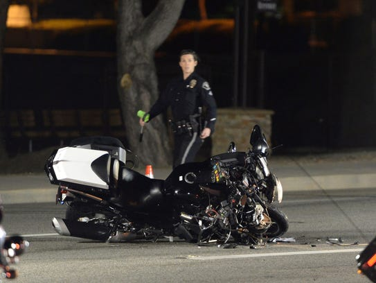 A damaged motorcycle is visible after a crash involving