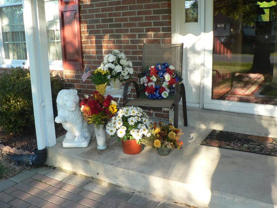 """Flowers on the porch of Edward F. """"Pete"""" Peterson's"""