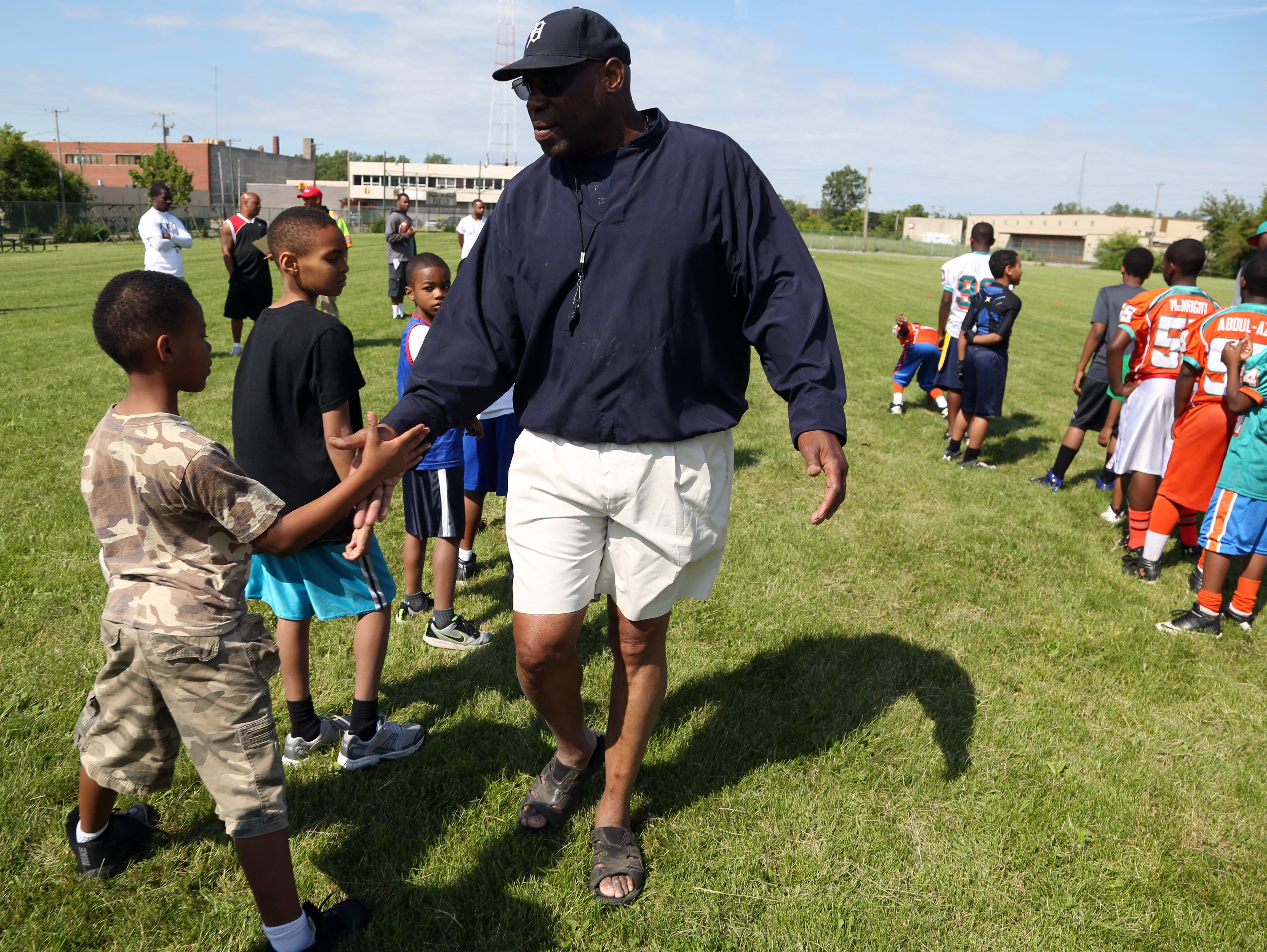 In June 2013, Reggie McKenzie, the former University of Michigan football and NFL player, encourages campers during the first of three days of his Reggie McKenzie All Pro Football Clinic at the Reggie McKenzie Field in Highland Park.