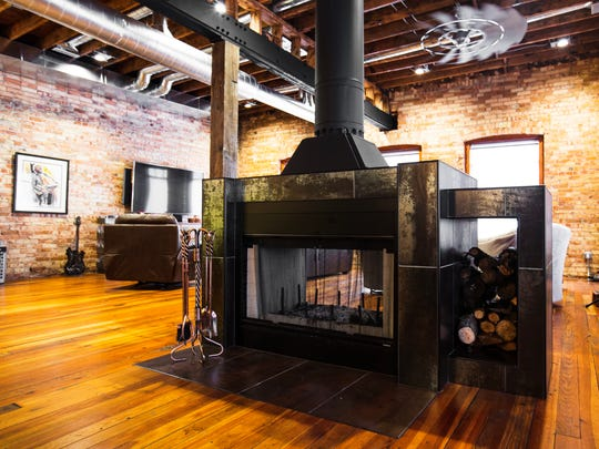 The bespoke fireplace was built little by little as the renovations were wrapping up.
