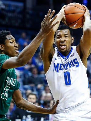 University of Memphis forward K.J. Lawson (right) drives to the basket against Tulane University defender Melvin Frazier (left) during second half action at the FedExForum.