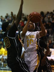 Pocomoke's Tyler Nixon goes up for a shot over Washington's
