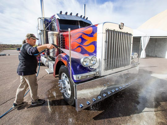 Pete Glavas of European Detail, hoses down the Optimus Prime stunt truck used in the Transformers movies. It will be up for auction at the Barrett-Jackson Collector Car Auction at Westworld of Scottsdale, which begins Saturday, January 23 and runs through the 31st.