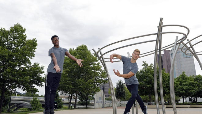 David Ward of BalletMet, right, poses with Vincent Van Harris of BalletMet 2 at Bicentennial Park. Ward is rejoining the company this fall after spending time as a freelance dancer.