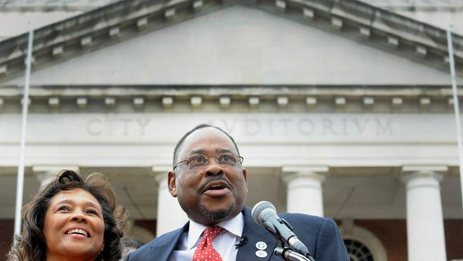 Dan Harris, with his wife Deborah Harris at his side, announces his candidacy for mayor of Montgomery in front of city hall in Montgomery, Ala. on Monday February 16, 2015.