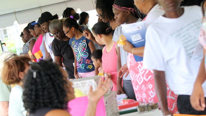 Members in the city's Northeast area wandering through vendors at the Wilmington Housing Authority empowerment fair at Kingswood Community Center on Wednesday.
