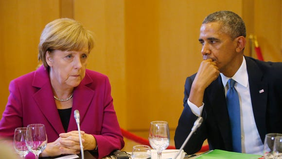 U.S. President Barack Obama, right, and German Chancellor