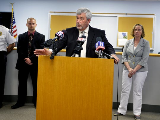York County District Attorney Tom Kearney announces that charges have been filed against Denzel Outen in connection to the death of Julianna Bower, 19, in this file photo from April 25, 2014. Behind Kearny are, from left, Newberry Township Police Chief John Synder, Detective Braxton Ditty and Coroner Pam Gay. Outen eventually pleaded  guilty to the charge in exchange for a 4 1/2- to nine-year prison sentence.