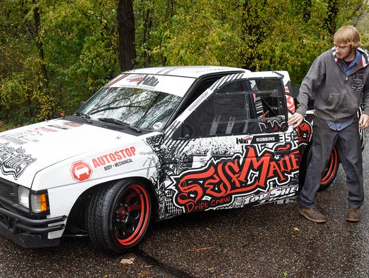 Alec Robbins gets out of his 1986 Nissan D21 drift