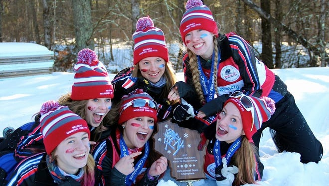 Abigail Opatik, from top left, Ally Swensen and Lauren Lackman celebrate the Wausau Nordic United state title with teammates, from left bottom, Erin Achatz, Olivia Dreger and Anna Buchberger