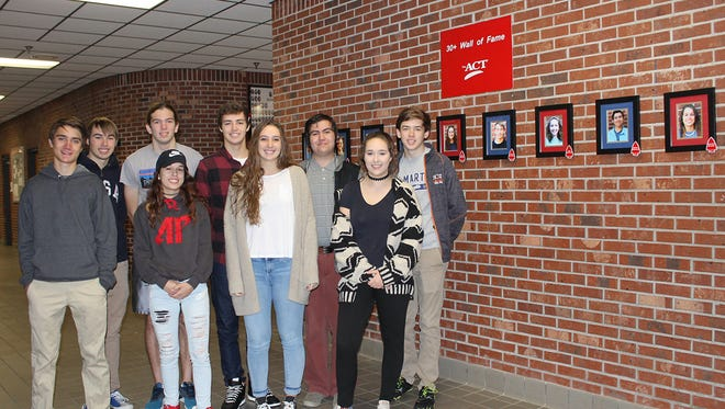 """Students at Harpeth High School who make a 30 or above on the ACT are being recognized in a special way. The school recently created the """"30+ Wall of Fame"""" and framed pictures of nine students already hang on the wall in the front lobby."""