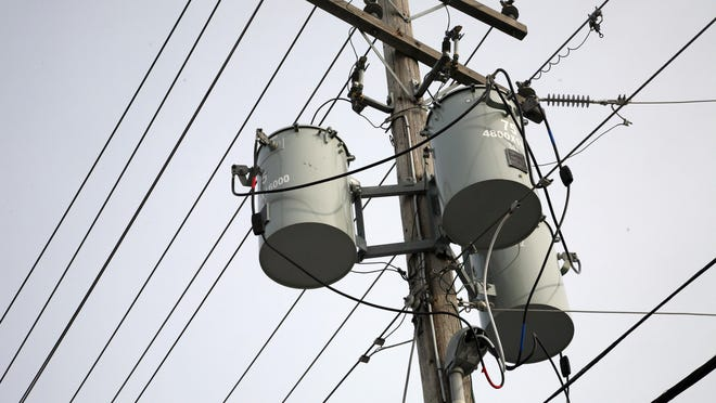 Utility pole with power lines and transformers
