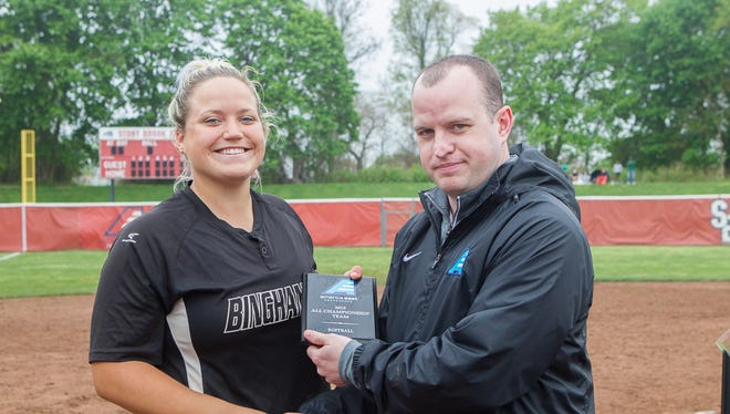 Binghamton University junior catcher Lisa Cadogan receives her America East Conference All-Tournament award from the conference's Director of Communications Sean Tainsh.
