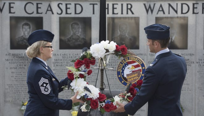 Photo by Staff Sgt. Peter Thompson  33rd Fighter Wing/Public Affairs    Subscribe 3  U.S. Air Force Col. Paul Moga, 33rd Fighter Wing commander, right, and Chief Master Sgt. Shelley Cohen, 307th Bomb Wing command chief, place a wreath in front of the burning sword during the Khobar Towers 21st Anniversary Wreath Laying Ceremony June 23, 2017, at Eglin Air Force Base, Florida.