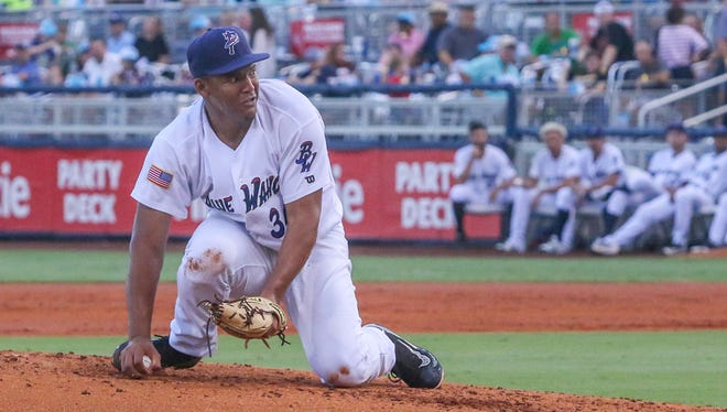 Pensacola pitcher Keury Mella (34) blocks the ball hit by Biloxi's Johnny Davis and quickly gets up to throw him out at first base on Tuesday, July 25, 2017.