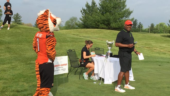 Bengals head coach Marvin Lewis  has a laugh while introducing his golf outing celebrities.