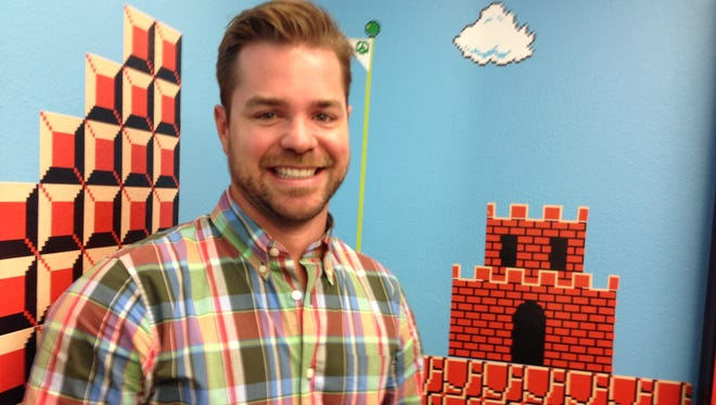 Jim Belosic of Shortstack stands in the Reno software company Super Mario Bros.-themed conference room.