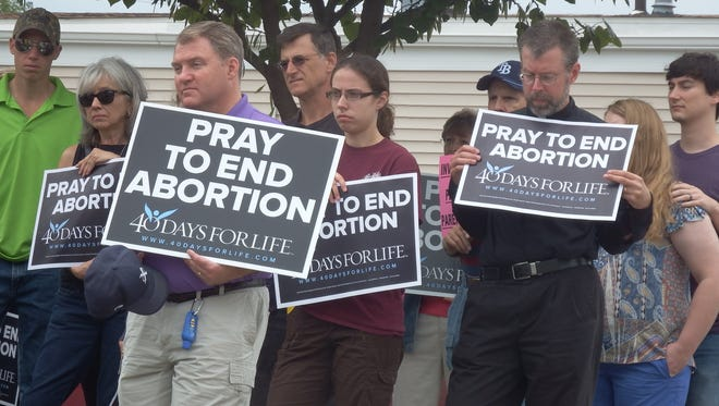More than 100 protesters stood in front of the Iowa City Planned Parenthood facility on Aug. 22 as a part of the National Day of Protest against Planned Parenthood.