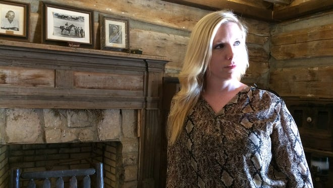 Sara Dulaney Pugh visits the Bell Cabin in Adams during a recent trip to Tennessee.