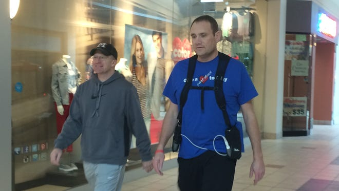 Paul Brester, left, and Rick Gilgenbach walk at Forest Mall to help improve their health after recent medical procedures.