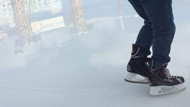 Wind and warmth helped hasten melting of the outdoor ice rink at Winter Park on Sunday.