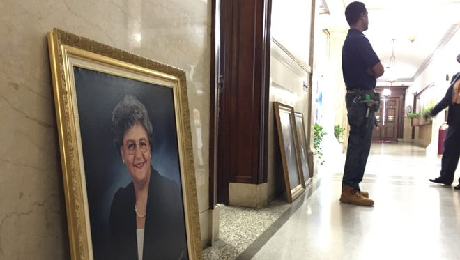 A mayoral portrait sits on the floor awaiting remounting on the wall on Feb. 23, 2016.