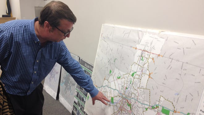 Keith Hall of Salisbury Planning and Zoning looks at a map of bike routes in the city.