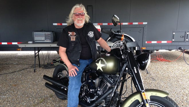 Regional manager of the Harley Owners Group JT Hensley sits on a Soft Tail Slim S Harley at the Louisiana State Fair in Shreveport.