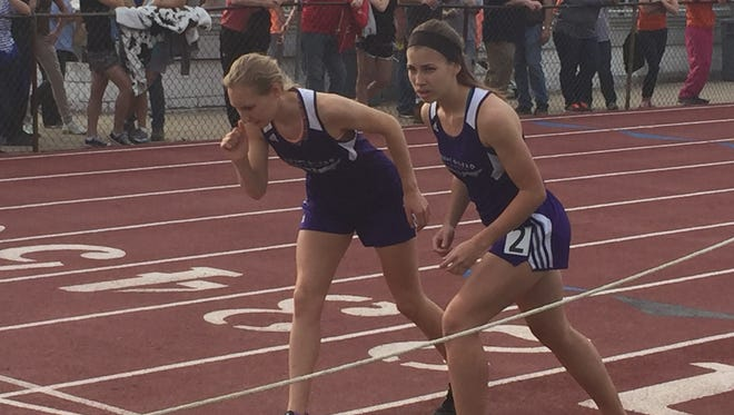 Mount Gilead's Jenna Shipman and Darcy Picker get ready for the start of the girls 800 at the recent Mid Ohio Athletic Conference Champoionships in Mount Gilead. The duo will compete in the 800 at this week's regional at Lancaster Fairfield Union.