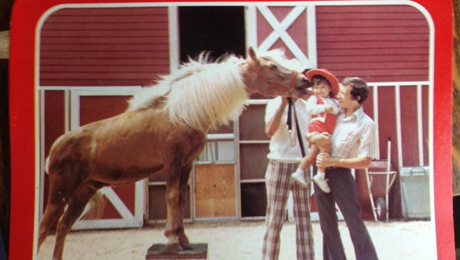 This postcard features Greg Merritt, the late son of Helen Merritt, owner of Pony Penning Enterprise inc. and her granddaughter, Crystal.