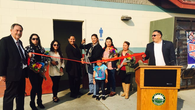 Left, Salinas Mayor Joe Gunter at last year's ribbon cutting of new restrooms at Constitution Soccer Field funded by the Neighborhood Beautification grant.