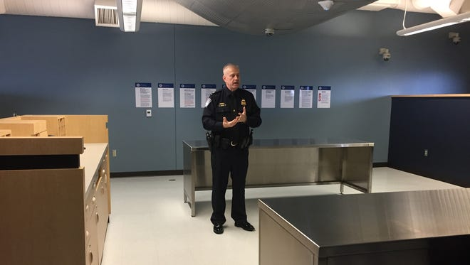Port Director Ky Neuleib talks about the features of the new U.S. Customs Office, located in the former airline terminal.