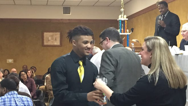 Marcial Ramos receives his varsity letter at Millville's Football banquet hosted by the Thunderbolt Club at the Millville Elks Lodge on Tuesday.
