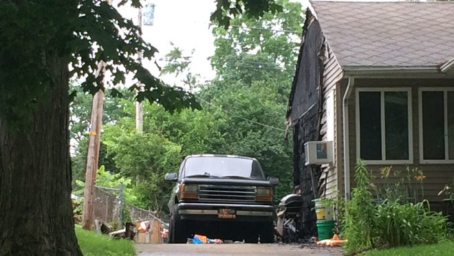 The side of a South 32nd Street house was damaged early Friday by a fire reportedly started by fireworks.